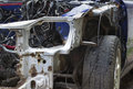Smashed car after accident on a wreckers yard outdoor horizontal shot Stock Photos