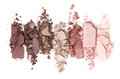 A smashed, neutral toned eyeshadow make up palette isolated on a white background Royalty Free Stock Photo