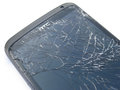 Smashed phone screen shattered glass on smart Stock Photography