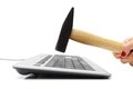 Smashing keyboard with hammer a Royalty Free Stock Photo