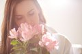 Smelling flowers portrait of lovely lady looking at and them Royalty Free Stock Image