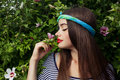 Smelling flowers trendy teenager model with big lips Royalty Free Stock Image