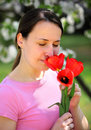 Smelling red tulips Royalty Free Stock Photos