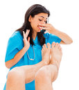 Smelly feet doctor defending herself from stinky man isolated on white Stock Image