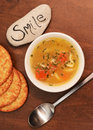 Smile with bowl of soup and crackers Stock Images