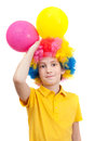 Smile boy in clown wig with two air balloons Royalty Free Stock Photo
