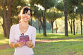 Smile brunette woman and her ebook Royalty Free Stock Photo