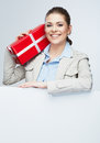 Smile business woman hold red gift box corporate bonus concept portrait with blank white board on gray female smiling model Stock Photography