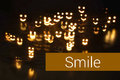 Smile concept gift card with shaped bokeh Stock Photos