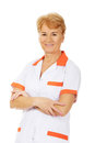 Smile elderly female doctor or nurse with folded arms Royalty Free Stock Photo