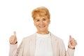 Smile elegant senior woman showing thumb up Stock Image