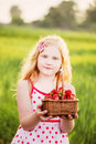 Smile girl with strawberry outdoor Stock Image