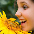 Smile Girl and sunflower Stock Photos