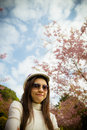 Smile lady with pink cherry flower tree Stock Photos