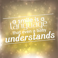 Smile is a language that even a baby understands motivational background Stock Photo