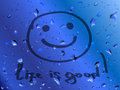 Smile life is good inscription on wet glass blue with and positive concept Royalty Free Stock Image