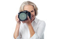 Smile please say cheese happy aged woman making clicks Royalty Free Stock Photo