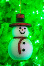 Smile snowman a on the christmas tree Royalty Free Stock Image