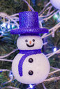 Smile snowman a on the christmas tree Stock Photography