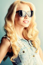 Smile sunglasses pretty blonde woman in smiling at camera jeans style Royalty Free Stock Photos