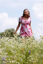 Smile teen open hands standing on field Royalty Free Stock Photo