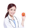 Smile woman doctor hold tomato Royalty Free Stock Photo