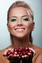 Smile woman offer your taste ripe cherry Royalty Free Stock Image