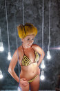 Smiled model in a bikini among lamps Royalty Free Stock Photo