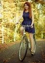 Smiled pretty girl enjoying autumnal weather. Royalty Free Stock Photo