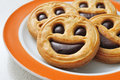 Smiley biscuits closeup of a plate with a pile of Stock Images