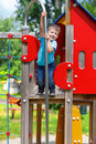 Smiley boy on playgroung cute years old smiling the top of playground Royalty Free Stock Image