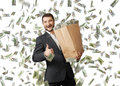Smiley businessman showing thumbs up successful and holding paper bag under dollar s rain and Stock Image
