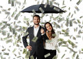 Smiley couple with black umbrella young standing under money rain Stock Photos