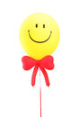 Smiley face baloon with a red bow tie isolated on white background Royalty Free Stock Photo