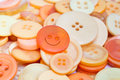 Smiley face button and buttons lots of in yellows orange Royalty Free Stock Images