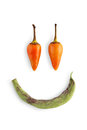 Smiley face of chili peppers isolated on white background Royalty Free Stock Photo