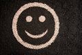 Smiley face drawing on soil from fertilizer granules Stock Photos