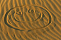 Smiley Face Drawn in Sand Royalty Free Stock Photo