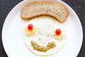 Smiley face from fried eggs Stock Photos