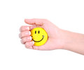 Smiley face in hand isolated on white Royalty Free Stock Photo