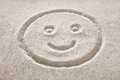 Smiley Face in the sand Royalty Free Stock Photo