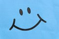 Smiley face symbol on plastic background Stock Photos