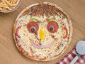Smiley Faced Pizza with a Portion of Chips Royalty Free Stock Photos