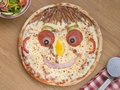 Smiley Faced Pizza with a Side Salad Royalty Free Stock Photo
