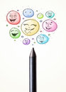 Smiley faces coming out of crayon coloured face bubbles Royalty Free Stock Images