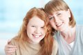 Smiley faces teenage girl and her mother looking at camera with toothy smiles Royalty Free Stock Photos