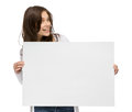 Smiley girl holding copyspace half length portrait of isolated on white Stock Images