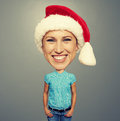 Smiley girl in santa claus hat over grey background Royalty Free Stock Photos