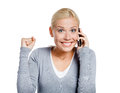 Smiley girl speaking phone her fist up isolated white Stock Photo