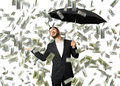 Smiley glad businessman with umbrella standing under money rain and looking up Stock Images